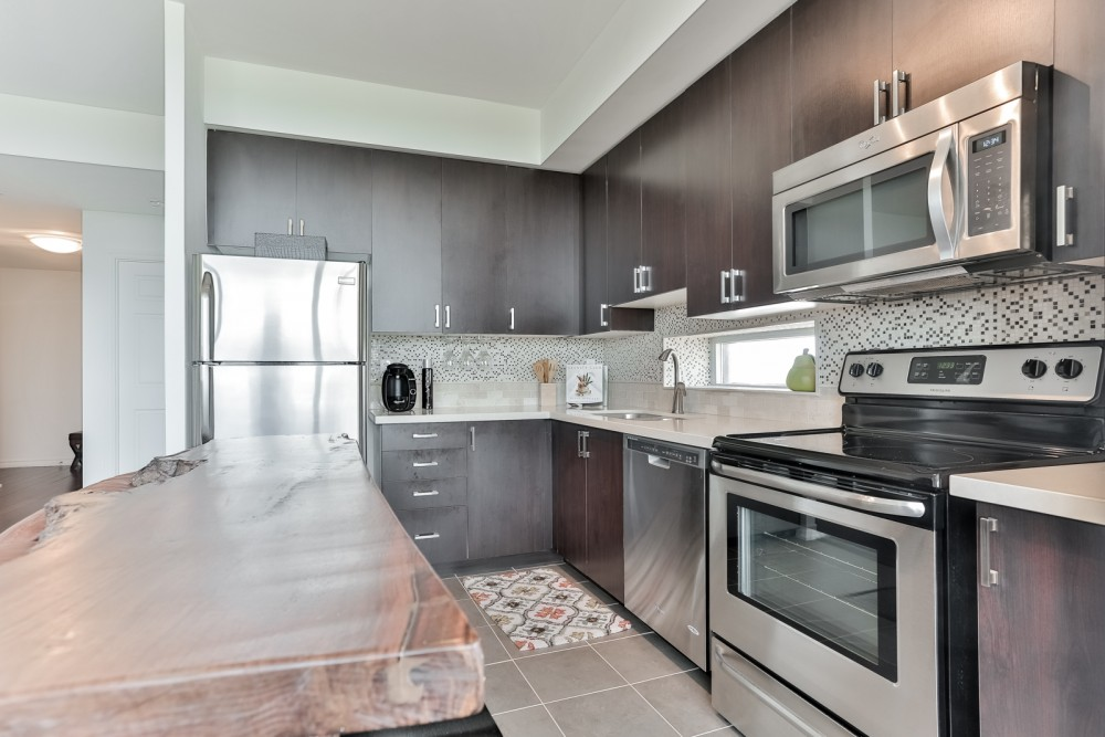 SOLD – 280 Donlands Ave 1 Bed Plus Den Condo with Parking